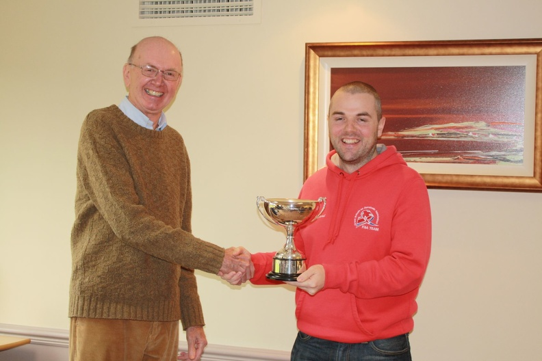 Matt is presented with the 'Optipower Cup' FAI League Trophy